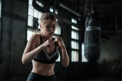 Female Boxer preparing for training in Boxing Club Royalty Free Stock Photography