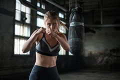 Female Boxer preparing for training in Boxing Club Stock Photo