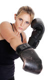 Female boxer punching. A female boxer punching isolated on white Royalty Free Stock Images