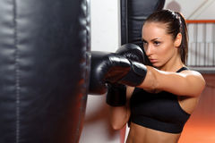 Female boxer with punching bag Royalty Free Stock Photo