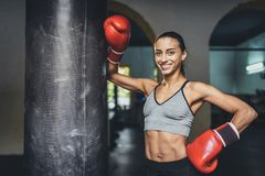 Female boxer with punching bag Stock Images