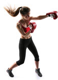 Female boxer punching wearing boxing gloves Stock Images