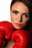 Female boxer red gloves Royalty Free Stock Photography