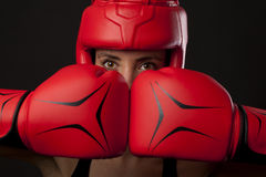 Female boxer in a self-defense posture Royalty Free Stock Image