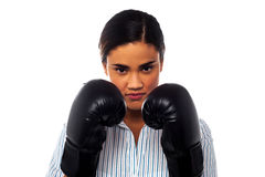 Female boxer with serious look on her face Stock Photos