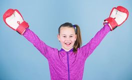 Female boxer. Sport upbringing. Boxing provide strict discipline. Girl cute boxer on blue background. Contrary to. Stereotype. Boxer child in boxing gloves stock photos