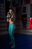 Female boxer in sportswear and in boxing gloves training Stock Photography