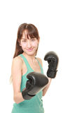Female boxer throws a right uppercut Royalty Free Stock Photo
