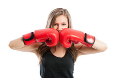 Female boxer touching red boxing gloves Stock Image