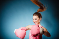 Female boxer wearing big fun pink gloves playing sports Royalty Free Stock Images