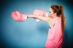 Female boxer wearing big fun pink gloves playing sports Stock Image