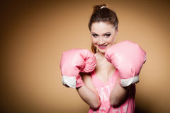 Female boxer wearing big fun pink gloves playing sports Stock Photo