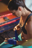 Female boxer wearing blue strap on wrist Royalty Free Stock Image