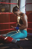 Female boxer wearing blue strap on wrist Royalty Free Stock Photography
