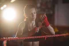 Female boxer wearing red strap on wrist Royalty Free Stock Images
