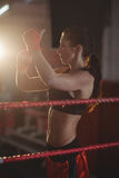 Female boxer wearing red strap on wrist Royalty Free Stock Photo