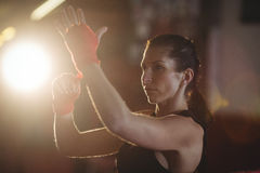 Female boxer wearing red strap on wrist Royalty Free Stock Photos