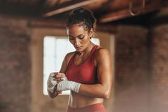 Female boxer wearing strap on wrist stock photo