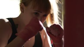 Female boxer working out with punching bag, relieving emotional stress in gym. Stock footage stock video footage