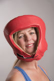 Female boxing wearing safety head gear Royalty Free Stock Photos