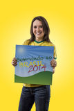 Female Brazilian fan celebrating Stock Photos