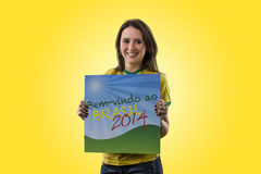 Female Brazilian fan celebrating Royalty Free Stock Image