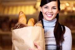 Female with bread Stock Images