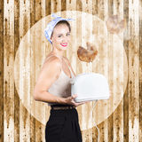 Female breakfast waiter with hot toast in toaster Stock Photos