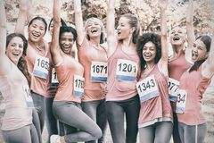 Female breast cancer marathon runners cheering Royalty Free Stock Photo