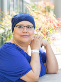 Female Breast Cancer Patient. Latina Female Breast Cancer Patient Wearing Medical Wrist Band Royalty Free Stock Image