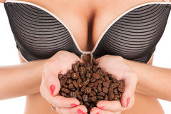 Female breast and coffee. In hand Stock Photography