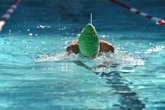 Female breaststroke swimmer at a swim meet Royalty Free Stock Photography