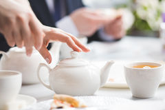 Female brews. The picture was taken during tea party Stock Photography