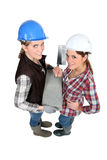 Female bricklayers. Stood close together Stock Photos