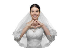 Female bride with hands shaping a heart symbol. Stock Image