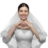 Female bride with hands shaping a heart symbol. Stock Photos