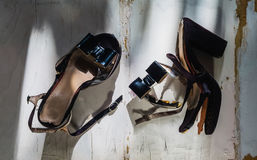 Female broken high heel shoes on grungy white wooden Royalty Free Stock Photography