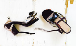 Female broken high heel shoes on grungy wooden background Royalty Free Stock Photography