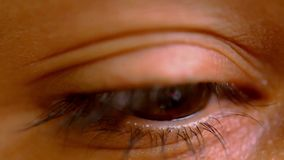 Female brown eye opens and wonders frightened. Royalty Free Stock Photos