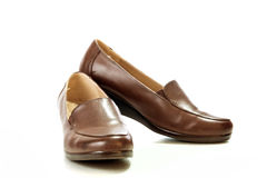 Female brown leather beautiful shoes isolated Royalty Free Stock Photo
