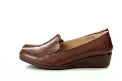 Female brown leather beautiful shoes isolated Stock Photo