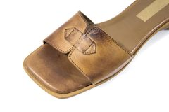 Female brown leather slipper on white background. Royalty Free Stock Images