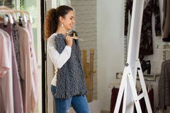 Female brunette choosing  blouse Stock Photos