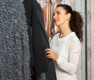 Female brunette choosing clothes Stock Photography