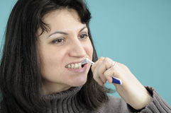 Female brushing teeth Royalty Free Stock Images