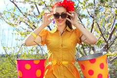 Female with buckets on garden Stock Photography