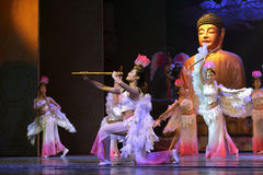 Female buddhist dance and play chinese flute Stock Photos