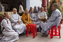 Female Buddhist monks. Chating in monastery in Disyrict 3 in Ho Chi Minh city in Vietnam Royalty Free Stock Photos