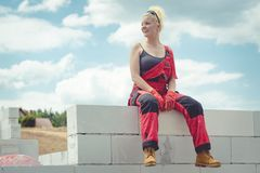 Female builder break on construction site royalty free stock image