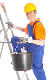 Female builder with bucket and ladder Royalty Free Stock Image
